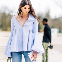 Lavender blouse paired with jeans and a statement earring // Photographed by George Angelis