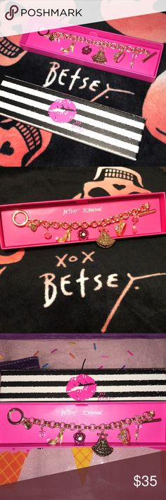 Betsey Johnson NWT! Charm Bracelet 👠 👗 🌹 👑 This is a brand new gold charm bracelet by Betsey Johnson with a toggle clasp. It is so adorable! The charms are: the Betsey heart, little pink crystal bead, gold glitter high heel shoe, pink sparkly rose with a clear jewel in it, a gold dress on a hanger, a crown fit for a princess and a three bead drop down charm with another pink crystal bead, small pearl and smaller pink bead. It is approximately 7 inches long.  Comes in an adorable BJ gift…