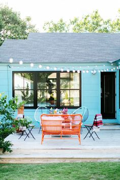 With Bonni Taylor Turquoise blue exterior siding! Love blue for a house exterior, plus this is a gorgeous, colorful backyardTurquoise blue exterior siding! Love blue for a house exterior, plus this is a gorgeous, colorful backyard
