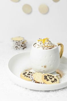orange hot chocolate with vanilla cream and stamped orange zest sugar cookies