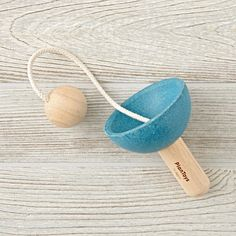 Enjoy catching a ball with the cup and ball. This classic toy is great for developing hand-eye coordination and fine motor skills.