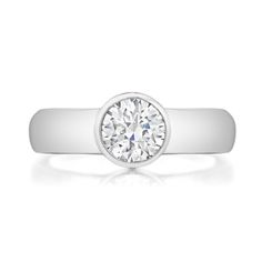 Round bezel set solitaire engagement ring. Can be made with a 4mm, 5mm, or 6mm shank.