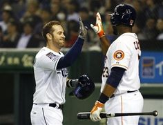 MLB All-Stars' Evan Longoria, left, celebrates with teammate Chris Carter after hitting a solo shot off Japan's Minoru Iwata in the sixth inning of Game 4 of their exhibition baseball series at Tokyo Dome in Tokyo, Sunday, Nov. 16, 2014. (AP Photo/Toru Takahashi) ▼16Nov2014AP Morneau leads MLB All-Stars to 1st win in Japan http://bigstory.ap.org/article/20a14f1a5cfe425eab0b1c3403af5762 #MLB_Japan_All_Star_Series_2014