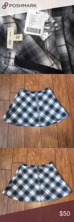 """NWT! Urban Outfitters GR MOTIF Plaid Mini Brand NEW. Fabulous Plaid Mini Skirt from Urban Outfitters. Brand is Silence + Noise. Colors are Gray, Black, and White. Hidden zipper in the back with option for button on top. Button is included in attached baggy. Polyester, Rayon, and Spandex blend. Machine wash. Tumble dry. Length is 13.5"""" from waist to hem. 26"""" across on the bottom. 13"""" width of the waist. Urban Outfitters Skirts Mini"""