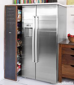 Scandinavian Inspired Kitchen - Scandinavian Design - House Beautiful    A pull-out pantry is tucked in next to Bosch's 800 Series refrigerator.