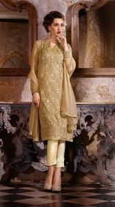 Stylish dark cream poly georgette capri trouser suit which is crafted with a resham embroidery work all over and lace work on the border. This outfit comes with a matching bottom and dupatta.This unstitched suit can be stitched in the maximum bust size of 42 inches...