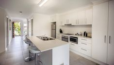 Executive Townhouses | Family Friendly Accommodation - Escape At Nobby's Washing Machine In Kitchen, Iphone Docking Station, Electric Bbq, Holiday Accommodation, Two Bedroom, Friends Family, Living Area, Townhouse, Catering