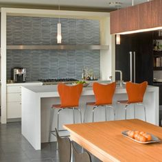 #orange you glad we discovered this #modern #kitchendesign by John Lum Architecture? The dimensional #tile #backsplash caught our eye as the #blue hue plays so nicely with the orange and #copper elements in the #interiordesign. And we love that the space is so modern it has #retro appeal! / #tiletuesday #kitchen #tiles #tiled #tiling #tilework #bluetiles #interior #interiors #interiordesign #interiordesigner #idcdesigners #instahome #instadecor #kitchenremodel #homedecor #midcentury…