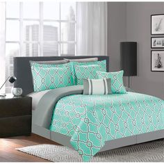 This lovely seven piece comforter set offers style and convenience with its geometric design in turquoise and grey and microfiber construction. This set is conveniently machine washable.