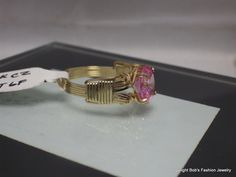 Oval Pink Cubic Zirconia In 14 Kt Gold Fill Wire   Here for your consideration is a gorgeous oval pink CZ gem cradled beautifully in 14 kt yellow gold filled wire setting. ... #jewelry #ring #wrapped #gemstone #sterling #ring