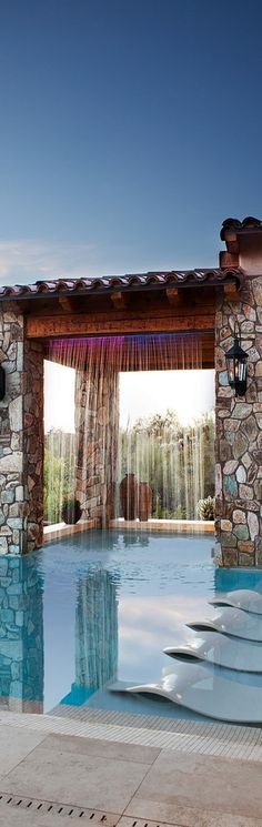 Pool with shower curtain and large window openings. Roofed in area provides shade.