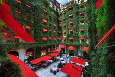Hotel Plaza Athenee, Paris. red awnings are awesome!