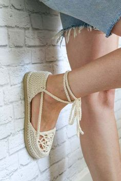Slip stitched chain ankle strap on a crochet sandal with rubber sole.