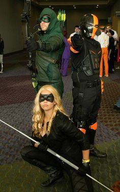 Mlcarr as CW Black Canary, her boyfriend, TJ McDonnell as cw Arrow and unidentified Deathstroke at Megacon 2014. Photo by Kali El