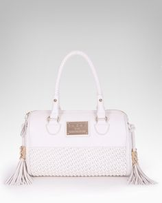 #bebe #wishesanddreams 7. A handbag for toting essentials - this cute creamy bag is spacious enough to fit the essentials, but also will go with every outfit! Double-duty pieces are important when you have limited luggage space