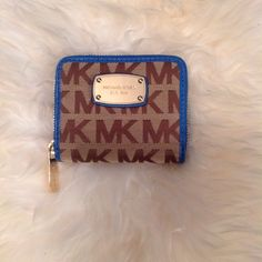 """Michael Kors Jet Set Signature Zip around wallet BRAND NEW WITH TAG COLOR: BROWN / BLUE MEASUREMENTS: 4.5""""(L) x 3.75""""(H) x 1""""(D) FEATURES: SIGNATURE JACQUARD WITH LEATHER TRIM  GOLD TONE HARDWARE ZIP AROUND CLOSURE INTERIOR LINED WITH SOFT LEATHER AND SIGNATURE FABRIC  FOUR CREDIT CARD SLOTS  ONE FULL LENGTH BILL COMPARTMENTS ONE SNAP CLOSURE COIN POCKET Michael Kors Bags Wallets"""