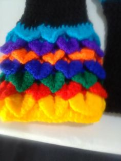 A very colourful pair of fingerless gloves made in bright rainbow colours. Texting or driving gloves. Rasta Colors, Rainbow Colors, Flower Spray, Driving Gloves, Holly Berries, Wrist Warmers, Festival Wear, Gay Pride, Hand Crochet