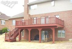 Trex Decking red with the brick and tan siding looks nice