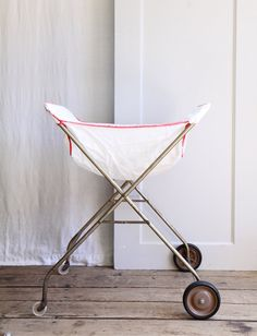 Vintage Rolling Laundry Cart.