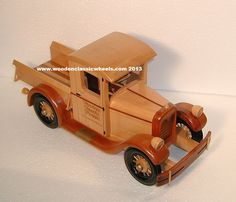 """1928 Chevrolet Pickup Truck  this antique had more class than any other year.  A must for your display or a great gift for the truck enthusiast.  Built from:  solid hard maple w / painted spoke wheels, walnut finders.  Approx. size 13"""" Long X 8"""" Tall X 8"""" Wide"""