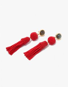 Drop earrings from Lizzie Fortunato in Red. Beaded tassel fringe earrings. Labradorite cabochon tops. Set in brass. Post back with clutch closure. Made in USA with imported materials. Sold as a set.  • Gold-plated brass • Made in USA