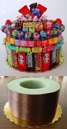 styrofoam base on cake board -- good idea -- use lollypops in styrofoam.