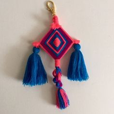 """Colorful Ojito Key Chain *Hand made key chain from artisans of Jalisco, Mexico.                                                                      *Every key chain is unique.                                        *About 9"""".                                                          *Looks great on bags, book bags or as a key chain.                                                                         *Price is FIRM! Accessories"""