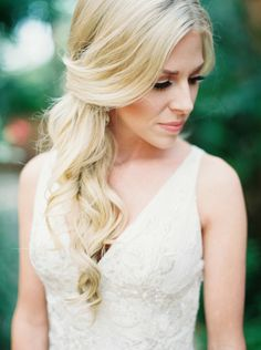 Romantic wedding hairstyle - Loose curls twisted and gathered gently to the side. #bridal #hair