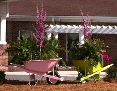 Why oh why did I sell the broken wheelbarrow at the yardsale- cute cute!