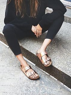 Arizona Metallic Birkenstock | High-shine Birkenstocks with metallic leather straps and monochromatic buckles. Soft Footbed design features an added layer of foam on top of the signature contoured cork footbed for extra cushioning.