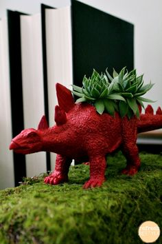 These are dino-rific. Fun bookends succulent planters Debbie Westbrooks This would be awesome to do to any hard plastic toy. Plastic Animals, Plastic Dinosaurs, Succulents Diy, Succulent Planters, Garden Inspiration, Houseplants, Container Gardening, Fun Crafts, Diy Projects