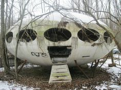 Abandoned 1968 Futuro House, Pennsylvania. Futuro, or Futuro House, is a round, prefabricated house designed by Matti Suuronen, of which fewer than 100 were built during the late 1960s and early 1970s. The distinctive flying saucer like shape and airplane hatch entrance has made the houses popular among collectors. The Futuro is composed of fiberglass-reinforced polyester plastic, measuring 4 metres high and 8 metres in diameter.