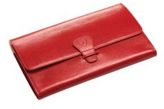 Aspinal of London, zipped travel wallet with passport cover in Berry Lizard, £195, aspinaloflondon.com