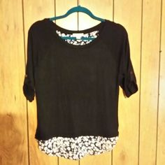 Black and white top nwot Sheer black front with flowered edge and back. Open black crosses in back at neckline. Black sleeves with roll up button tab. Rayon and spandex, size sm and new Zenana Outfitters Tops Blouses