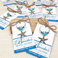 Beach Bridal Shower Favors, Beach Bridal Shower, Starfish Charm, Wine Charms Personalized, Bridal Shower Favors, Bridal Shower Wine Charms _____________________________________  You will be proud to give these beach bridal shower starfish wine charms as gifts! ____________________ DESIGN: -Cute, unique, professionally designed by a graphic artist -Beautiful light colored tropical beach background -Personalized with your name and date -A hint of rustic style with a jute accent -Available in…