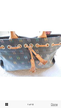 Dooney Bourke D B Multicolor Black Background Tassel Tote Handbag Nice | eBay
