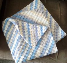 Corner to corner baby blanket in self striping yarn...blue, taupe, white and yellow. Perfect for a boy or that little girl who is not into the frilly borders! Can be remade in your color scheme or take this one home now! On Sale for only $30...postage added on for those out of the region.