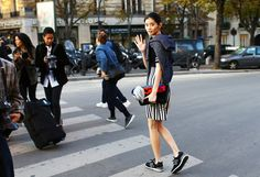Ming Xi in New Balance sneakers and a Fendi keychain