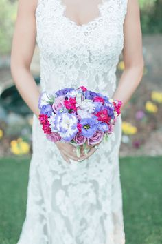 A gorgeous bouquet of pink and purple. Photo credit: The Lockharts. Wedding Flowers: Jack and Rose Florists.