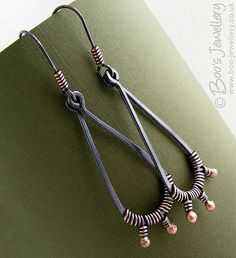 oxidized copper wire wrapped earrings by boo's jewellery, via flickr. would like to see these with bead drops  -mk