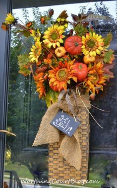 Worthing Court: Front door arrangement with fall florals embellished with burlap ribbon and a mini chalkboard