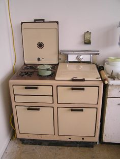 Old Bengal gas stove. Two-toned enamel for $425. I would choose a different color or two. A rich cream color would work well I think...