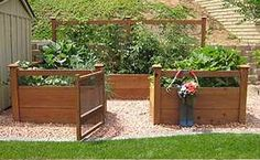 Very cool garden feature - raised beds in a closed garden space. Add a counter, BBQ, and bar stools...