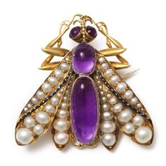 Victorian insect brooch/pendant set with natural pearl wings and amethyst head and body. By Giuliano, English, ca. 1890