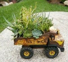 Old Vintage Tonka Truck Flower Planter. Creative ways to add color and joy to a garden, porch, or yard with DIY Yard Art and Garden Ideas! Repurposed ideas for the backyard. Fun ideas for flower gardens made from logs, bikes, toys, tires and other old junk. ~ featured at LivingLocurto.com