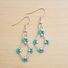 Bead Earrings This clever design uses bugle beads and seed beads and is a lot simpler than it looks! Bugle beads really lend themselves to bold, geometric shapes, and originally I was going with something triangular, but it evolved into