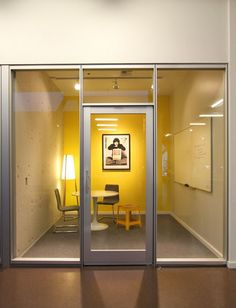 Lighting makes this small meeting room inviting