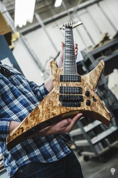 Michael Tempesta showing me Dave Davidson from Revocation's new Jackson Guitars - Official! Warrior 7 from another angle! @2013 Bulb  Photography — at Fender Guitars.