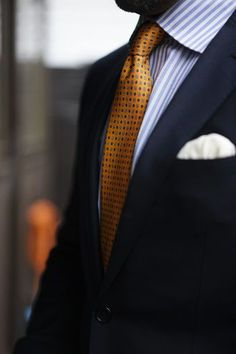 Navy jacket, white shirt with light blue candy stripes, orange tie with medallions #fashion&#style: