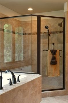 Angled 2 sided glass and tile shower with listello, Kohler DTV prompt digital shower, oil rubbed bronze shower door, oil rubbed bronze kohler shower fixtures, integral tub and shower deck by Belman Homes in 2012 MBA Parade of Homes The Roycroft #belmanhomes #waukeshabuilder #milwaukeebuilder